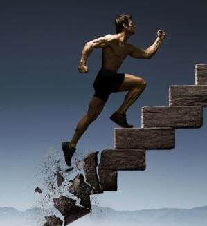 man_running_up_crumbling_stairs